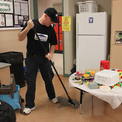 James mopping a floor.